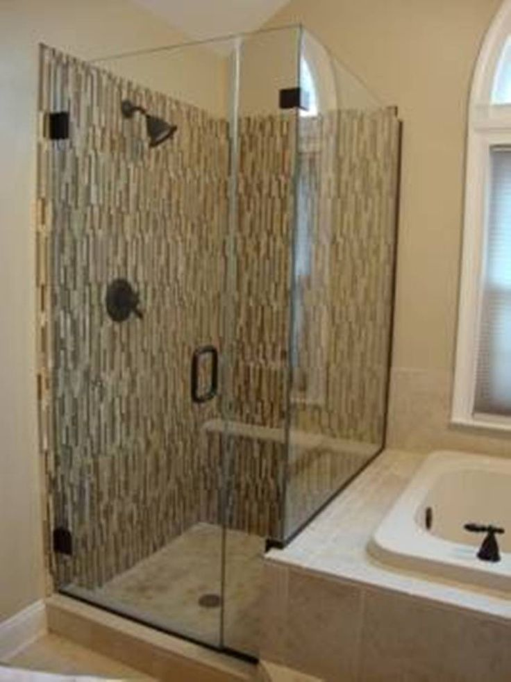 Frameless corner shower stalls for small bathrooms for Bathroom designs with corner bath