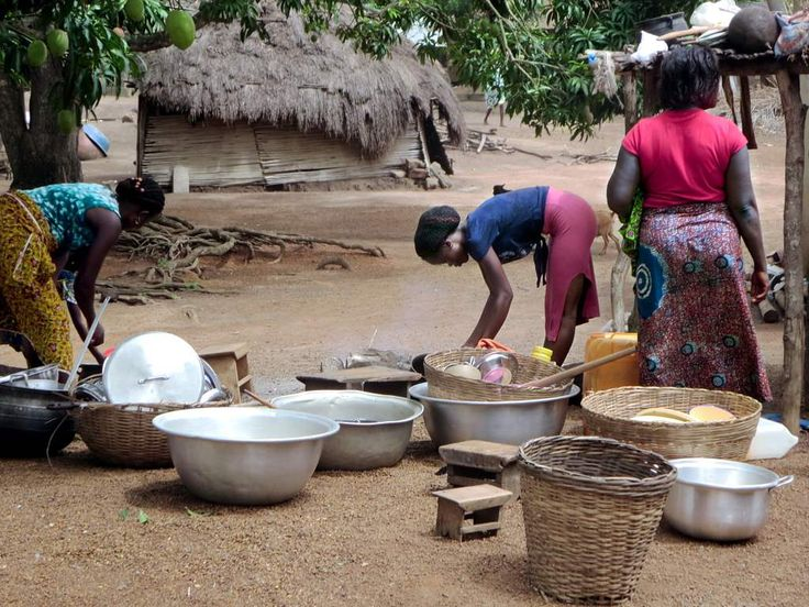 Women washing dishes at Mekoviade village, just north of Assahoun, Togo.