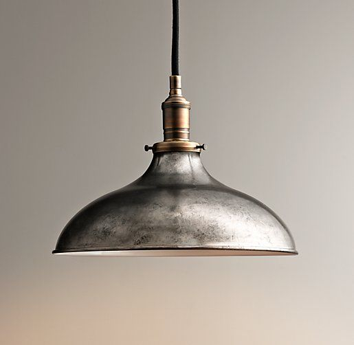 "Industrial Era Task Large Pendant 12.5"" diameter $189 Inspired by fixtures found in industrial settings, our classic pendant is the ideal choice for illuminating the task at hand.  Iron patina finish and pewter shade with antique brass finished accents give it all the vintage authenticity of the original Crafted of iron Includes an adjustable 6' cord and a ceiling-mounted canopy"