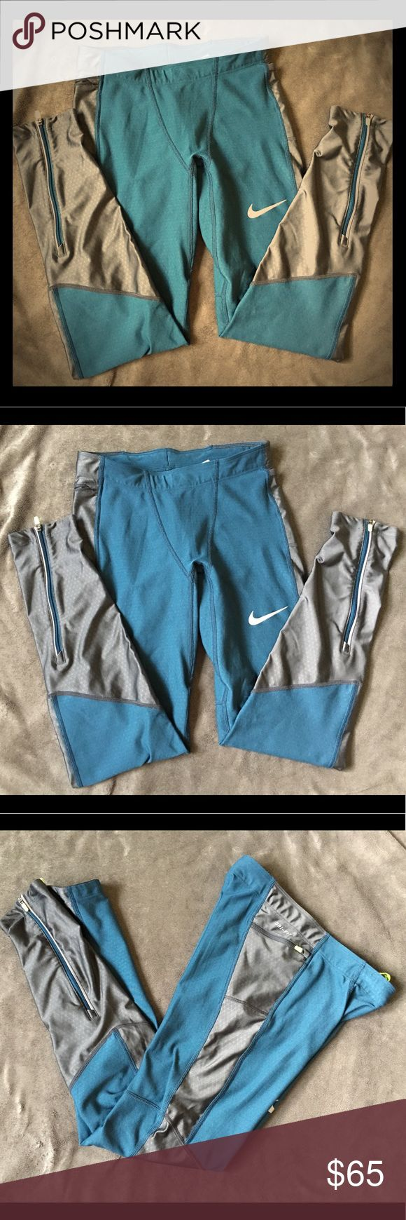 Nike Men's running tights Like-new running tights. Teal mesh and grey tights, zipper on the back ankles and grip on the hem to help keep them from bunching. Interior drawstring. Beautiful condition. Nike Pants