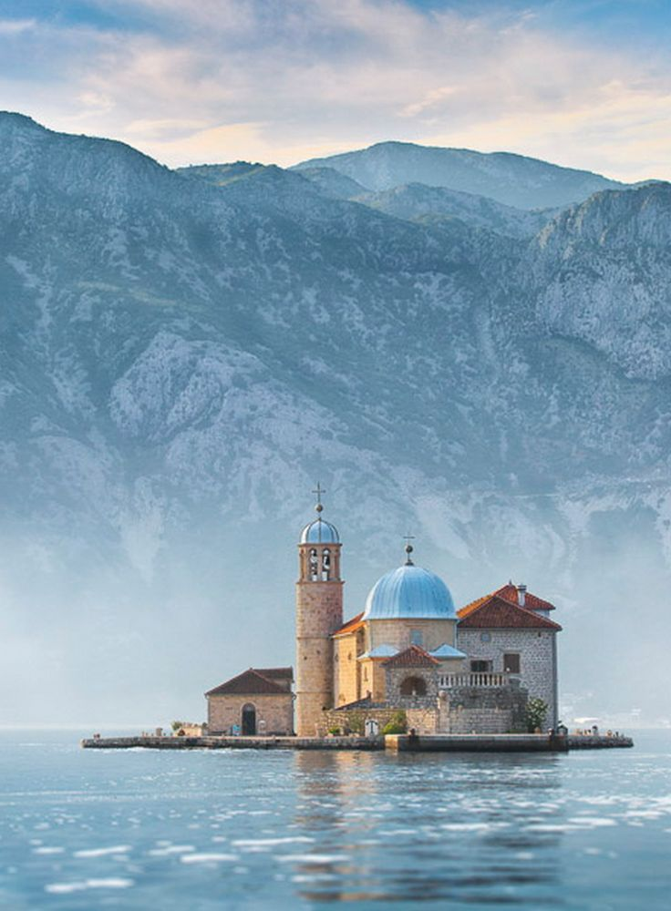 Our Lady of the Rocks, Perast, Montenegro. An artificial island created by bulwark of rocks and by sinking old and seized ships loaded with rocks. The islet was made over centuries by local seaman who kept an ancient oath after finding the icon of Madonna and Child on the rock in the sea, July 22, 1452.