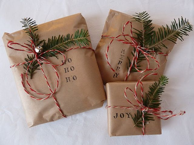 simple Christmas gift wrap: brown paper, stamps, evergreen, bakery twine