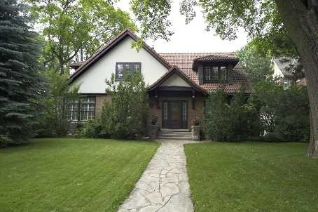 This magnificent home emanates that 'Old World' atmosphere.  A blend of elegant original details with modern renovations.  Sprawling 1 1/2 storey High Park mansion...A long time admired property.  Impeccable wood trims, french doors, 4 fireplaces, centre hall plan.  Total renovated kitchen with walk out to flagstone patio, garage convert to library, office & seperate art studio by professional architect.  Very rare & unique High Park property.