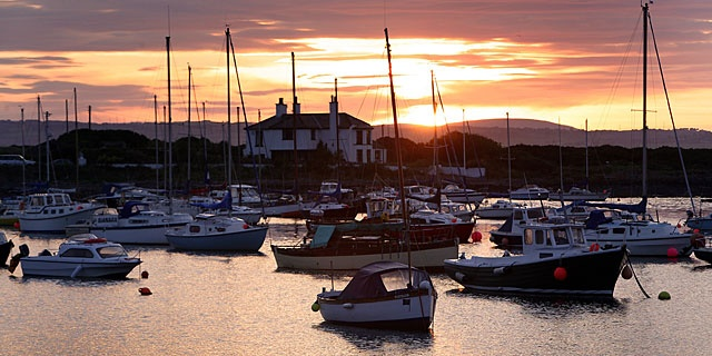 Sunset over the bay,Groomsport, County Down, Northern Ireland. The Antrim hills clearly visible across Belfast Lough behind.