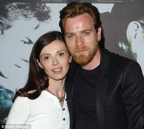 Happily married: Ewan McGregor with his wife, Eve  Mavrakis, who he met on the set of Kavanagh QC, before he became a big name in Hollywood They married in 1995 and now live in Los Angeles with their four daughters, Clara, 15, Esther, 10, Jamiyan, 10, and a one-year-old.