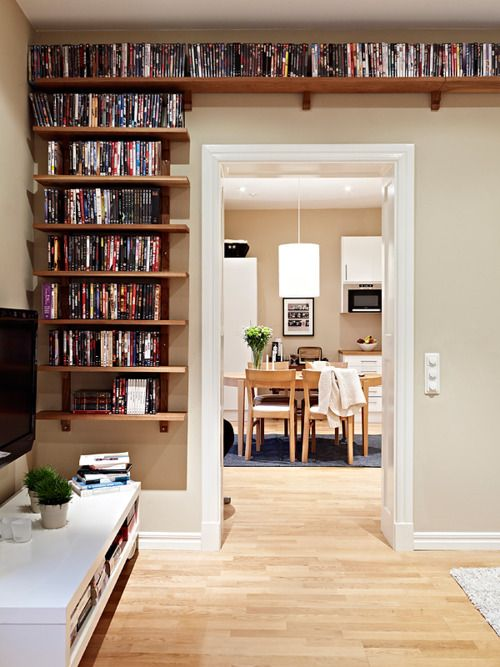 I love the use of wall space, and I love doorways and short hallways like this. I'm thinking of doing the hall to the kids' rooms like this...