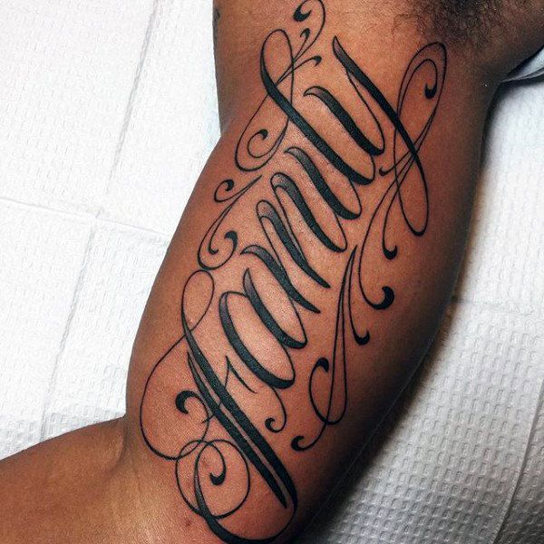 Guy With Family Letterings Tattoo On Upper Arms