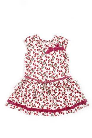 Vestido para niña, con estampado de florecitas rojas sobre fondo blanco.