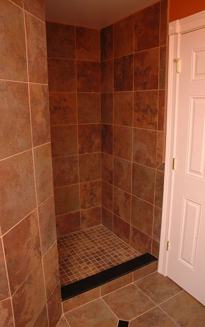 a simple design creates a doorless walk in shower that is accessible and easy to