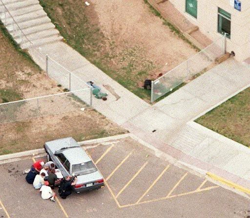Eric Harris | Shooting 2 | Murderpedia, the encyclopedia of murderers   An aerial view shows a triage area near Columbine High School in Littleton. Medics tend to the wounded in the wake of the massacre.