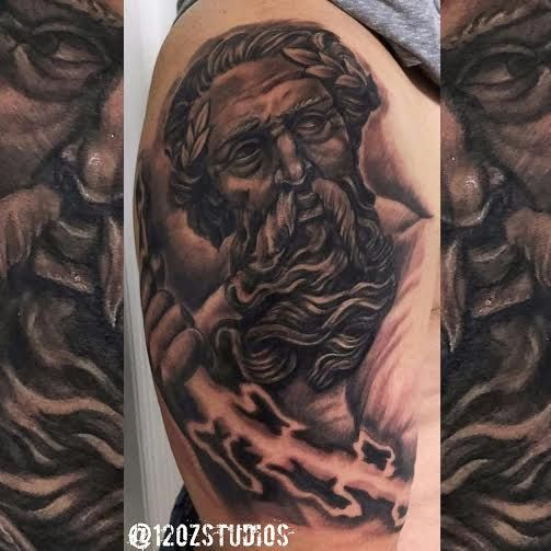 Absolutely stunning black and grey Zeus tattoo with lightening by Alex Feliciano.