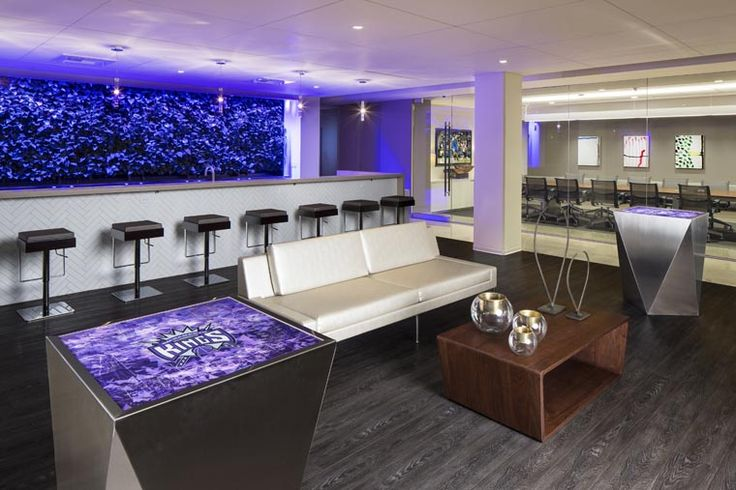 Purple lights glow over the lounge at the new hospitality marketing suites for the Sacramento Kings. AECOM has been working with the team to complete the architectural, engineering, interior, and landscape architectural design for the new Entertainment and Sports Center to reinvigorate the heart of the downtown capitol city. These marketing suites offer corporate clients and individual season ticket holders an opportunity to get the feel of the new arena prior to completion.