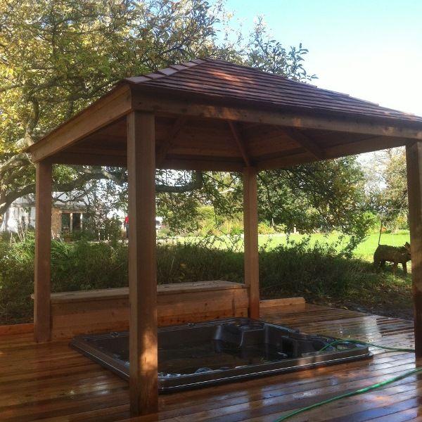 Sunken hydropool spa pool in a cedar deck platform with for Pool platform ideas
