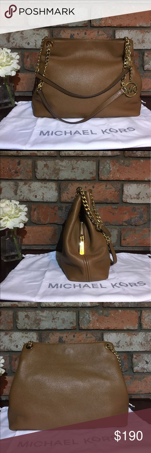 "Michael Kors Jet Set Large Leather Acorn Blemish Acorn Brown 100% guaranteed Michael Kors product w/blemishes Item is brand new with tags-has a few faint pen marks. Blemishes in photos.  Polished logo hardware & pull-through chain straps provide refined finish for an organized shoulder bag in supple, pebbled leather. Magnetic-snap closure. Interior center zip compartment; zip, wall, smartphone pockets. Can fit 13-15"" laptop Logo-jacquard lining Calf skin leather  *THIS BAG HAS A FEW FAINT…"