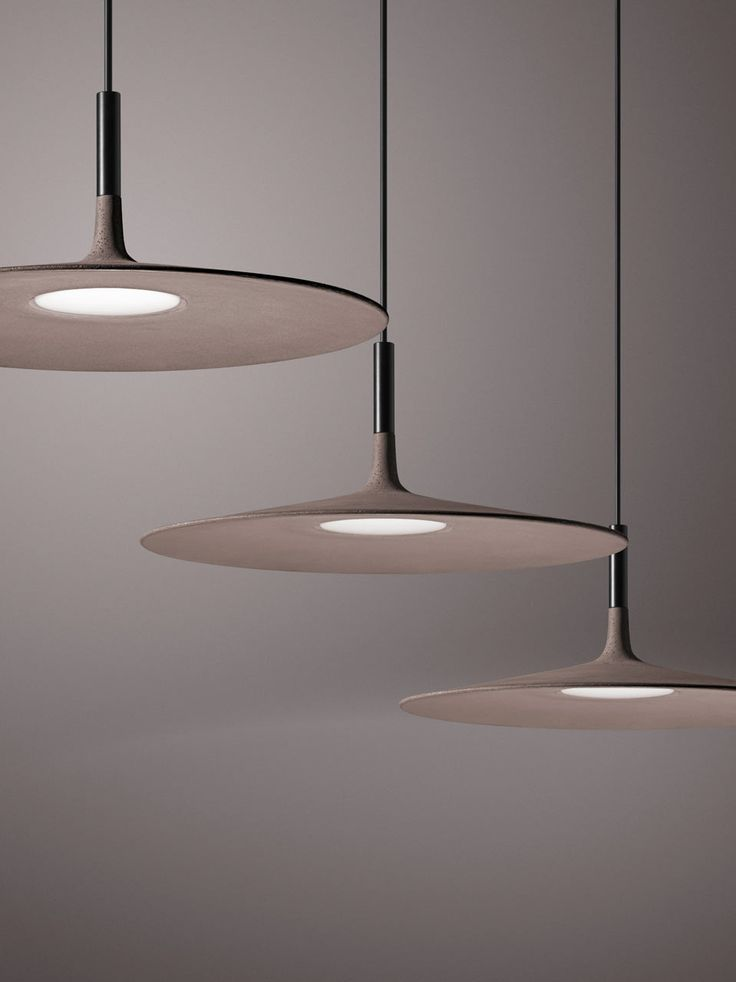 Foscarini launches Aplomb Large with a wide, flattened silhouette, which could be compared to a UFO, making it hard to believe that it's made of concrete.