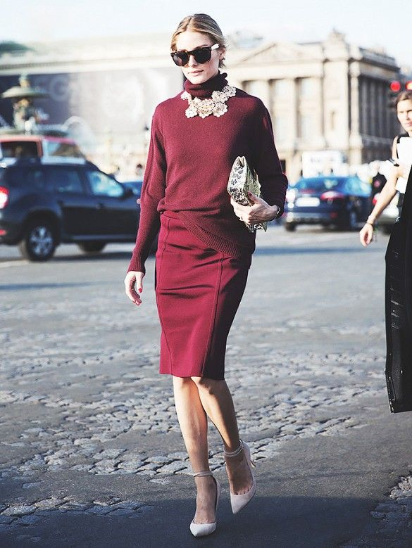 Olivia Palermo half tucks a red turtleneck into a matching pencil skirt while accessorizing a statement necklace.