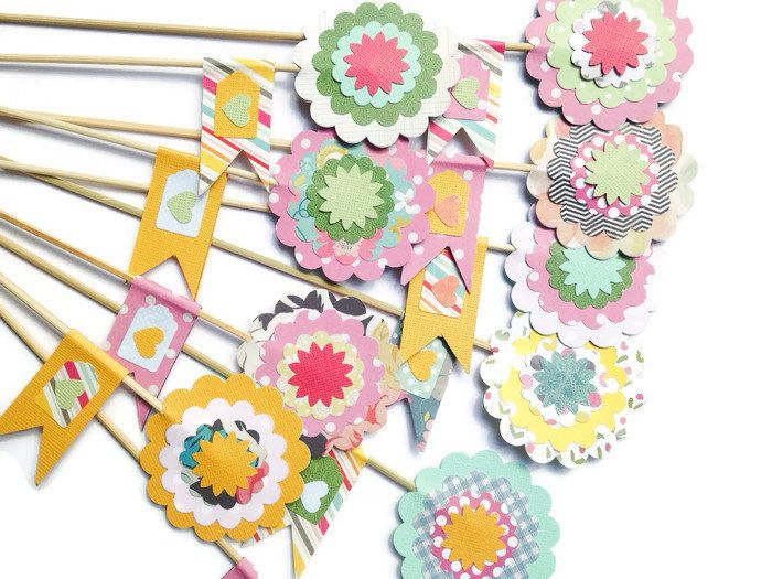 A personal favourite from my Etsy shop https://www.etsy.com/uk/listing/277917142/cupcake-toppers-flower-on-sticks-paper