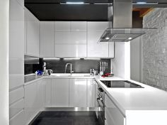 Modern u-shaped kitchen design with black and white theme