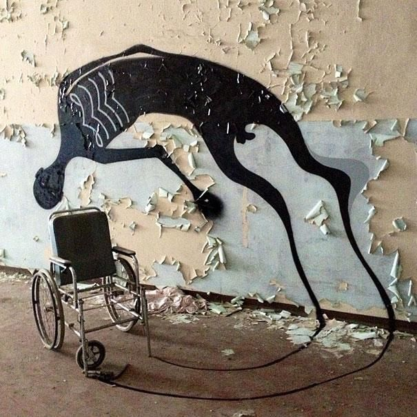 Brazilian artist Herbert Baglione draws haunting shadows in an abandoned psychiatric hospital in Parma, Italy