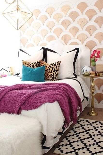 Pops of your favorite colors and patterns can create your happy place! This bedroom boasts of unique style with the accent wall, cozy throw and metallic side table!