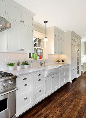 great use of space in this white galley kitchen. love the farmhouse sink. White and no soffit.