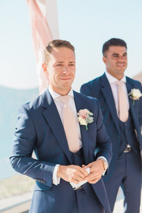 Adorable first look moment: http://www.stylemepretty.com/destination-weddings/2015/12/30/classically-elegant-santorini-wedding/ | Photography: Anna Roussos - http://annaroussos.com/