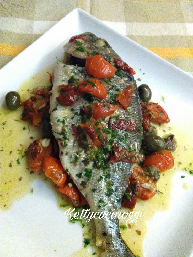 Mediterranean sea bream with tomatoes and olives