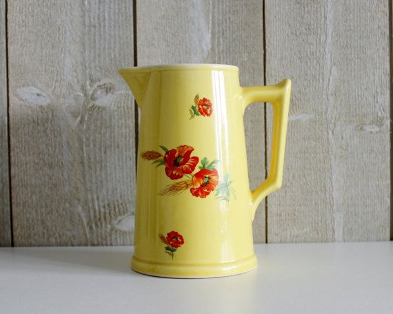 Bonjour,  This is a Vintage French yellow water pitcher. Unmarked but this is typically a form of DIGOIN Sarreguemines.  Made of beautiful, solid yellow ceramic with red flowers.  In good vintage condition, no chips , cracks or lines. .. only inside the pot are spots of aging which is very normal for this old pot   Dimensions ( without handle ) ∅11 x 17.5 cm // ∅ 4 3/8 and 6 7/8 height Weight: 0.570 kilos ( 1.25 lbs ) unpacked  If you purchase multiple items I happy to combine the shipping…
