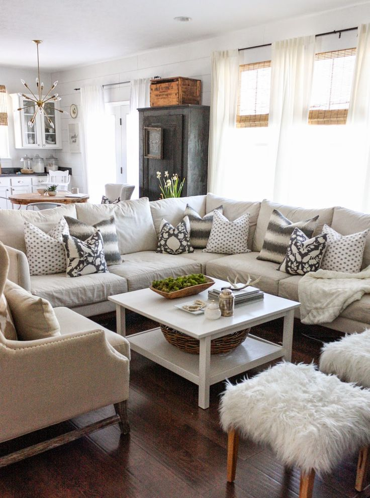 Neutral Living Room With Sectional, Patterned Pillows, Ikat, Fur, White  LOVE The Stools!