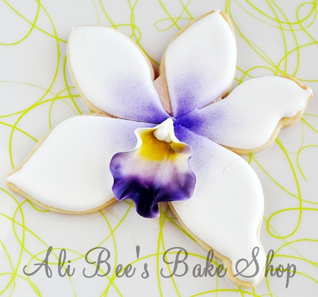 Orchid cookie by Ali Bee's Bake Shop  Beautiful cookie, an orchid is hard to replicate, wonderful work!