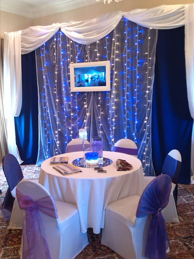 Bridal table backdrop fairylight curtain with promotional television screen for Cassia Burch Wedding Expo Palmerston North April 2014