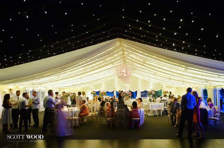 Chippenham Park wedding. Wedding Marquee with a street style opening onto the gardens of Chippenham Park Lodge in Cambridgeshire . A great party vibe achieved! Image by Kevin at Scott-Wood Photography.