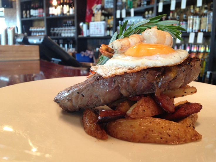 Rump Steak w/ spicy potato wedges, chorizo, fried egg , grilled prawns & pepper sauce (gluten free). Available today while stocks last. Available @ The Quarie.