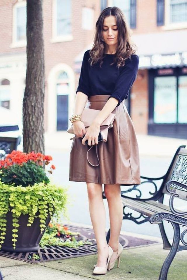 A-shaped leather skirt. Love this look. Would make the skirt pencil style to better compliment my body though :)
