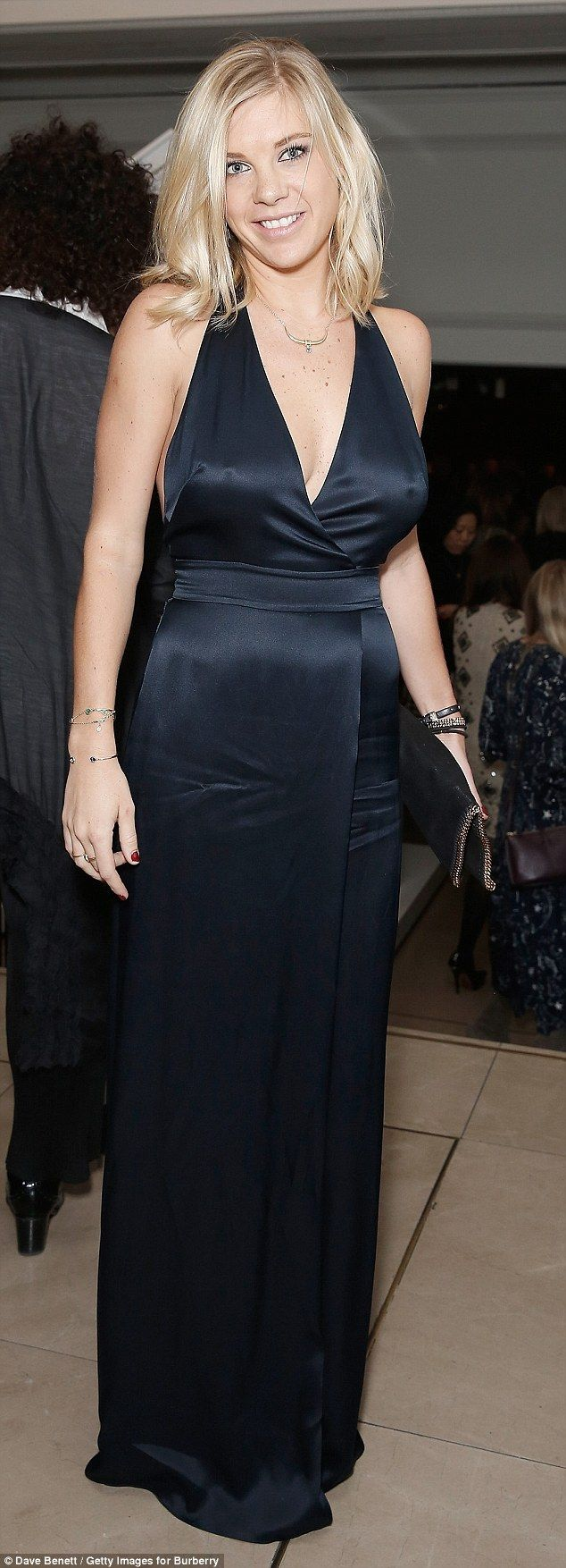 Chelsy Davy looked slinky in a sexy satin dress as she joined a host of celebrities at the...