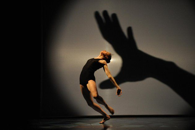 """A dancer performs in """"Panorama"""" a play by French choreographer Philippe Decoufle at the Theatre national de Bretagne in Rennes, western France. (AFP Photo/Thomas Bregardis)"""
