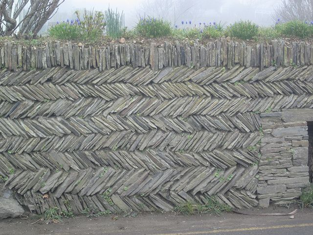 Cornish Herringbone dry stone wall. On our recent trip to the UK, we saw quite a few walls in this pattern, especially in the village of Tintagel.  So pretty!  Would love to have one some day.
