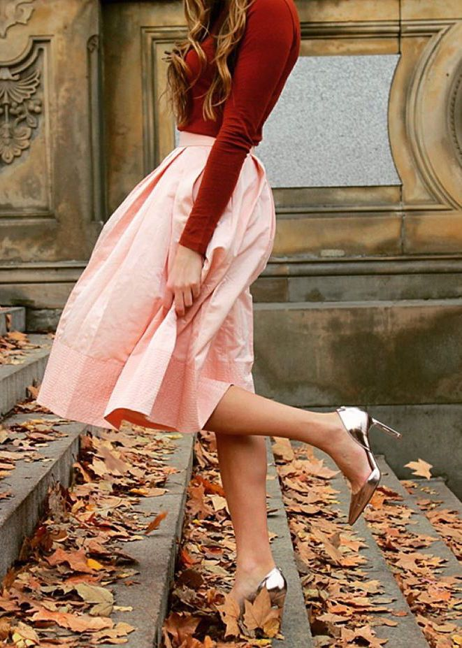 Feeling this fall outfit on Andrea Pion! She pairs our blush taffeta midi-skirt with a red long sleeved tee and metallic silver pumps for a classic holiday style | Banana Republic