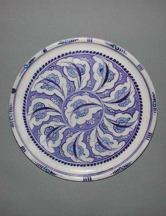 Maker:    Unknown; potter    Collection:    Henry Scipio Reitlinger    Category:    fritware (stonepaste)    Name(s):    dish  Islamic pottery; category  Iznik; category    Date:    circa 1535 — 1545    School/Style:    Ottoman    Period:    mid 16th century