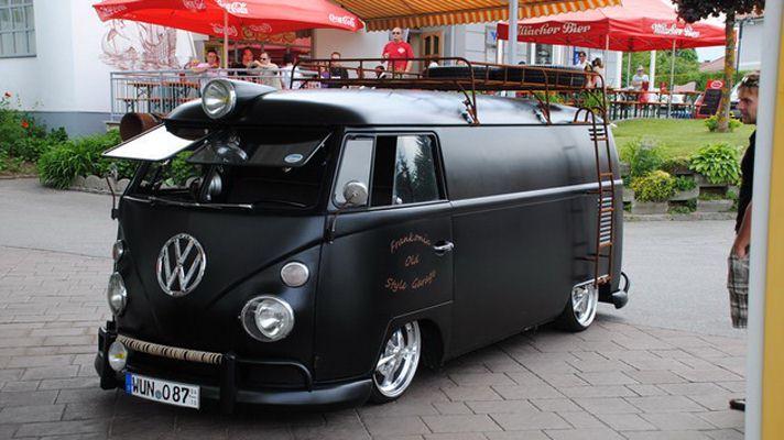 Split screen, satin black VW microbus looks sinister
