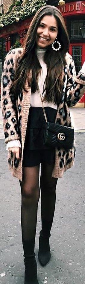 #spring #outfits woman wearing black and pink leopard print cardigan with leather gucci crossbody bag. Pic by @threadweather
