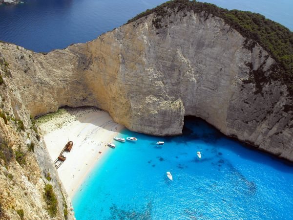 Zakynthos, Greece. Often referred to as 'Smugglers Cove', Navagio Beach (Ναυάγιο) is an isolated sandy cove on Zakynthos island and one of the most famous beaches in Greece. Summer 2004