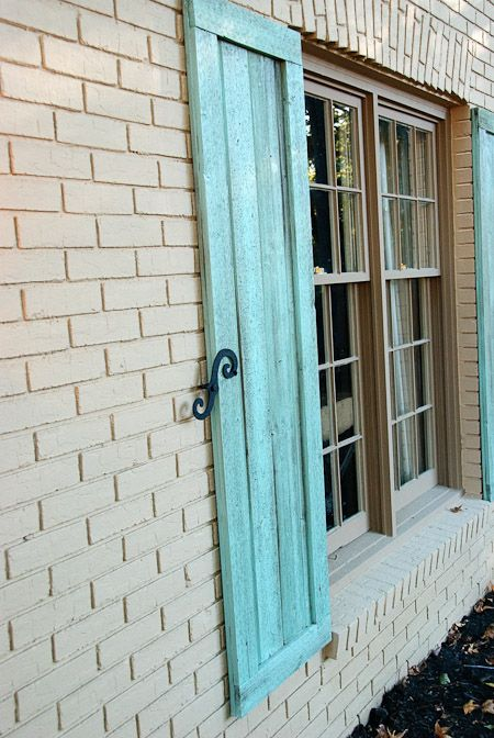 Love The Color Of The Shutters With The Painted Brick