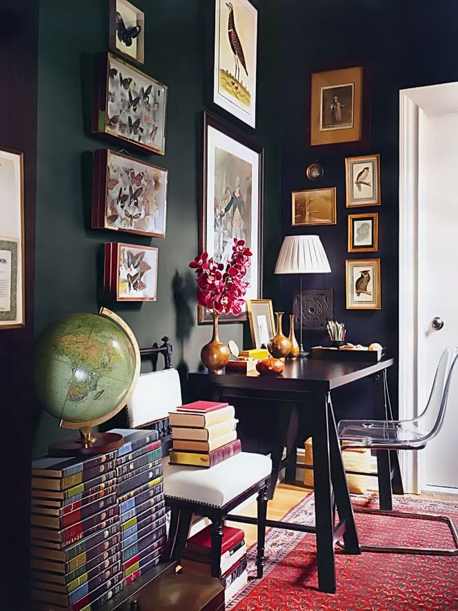 The dark paint in this room adds to the drama of the space and makes it a more indulgent and opulent place to be.  I'd love to have a workspace like this- a real sense of tradition.
