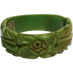 Vintage Green Carved and Pierced Bakelite Clamper Bracelet - available from THe Vintage Jewelry Boutique on Ruby Lane.