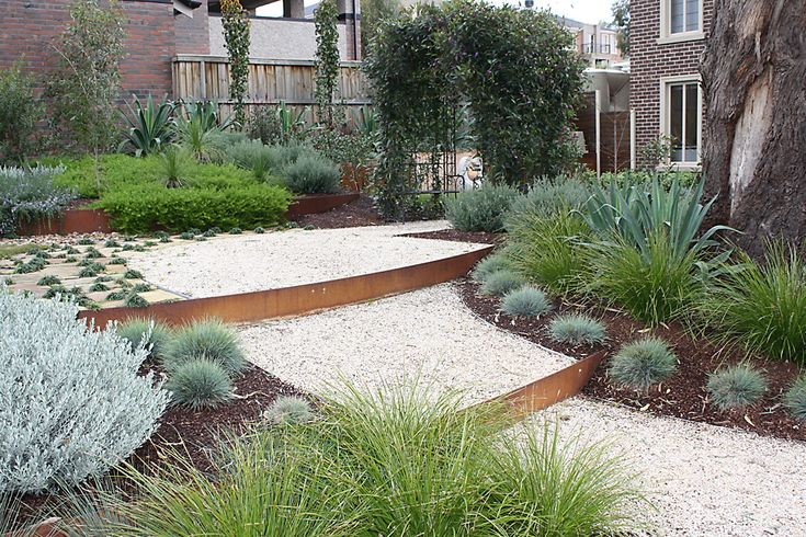 Steel steps created out of corten steel garden edging.