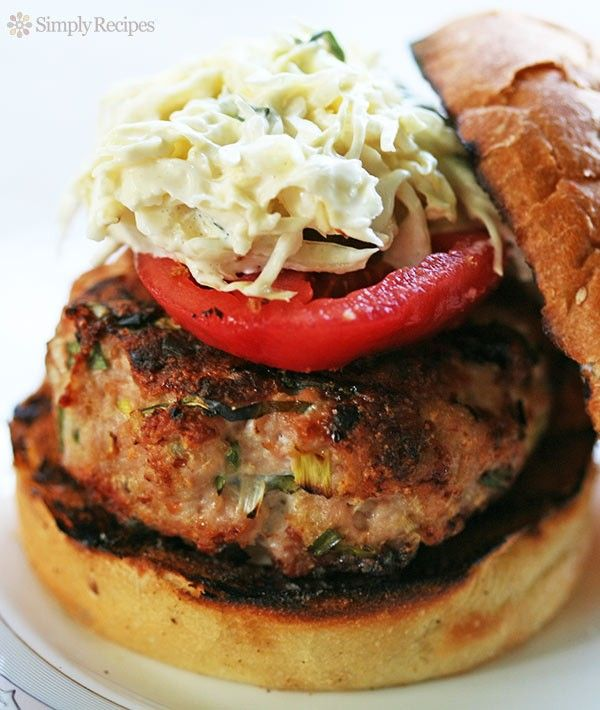Spicy Grilled Turkey Burger with Coleslaw ~ Spicy grilled turkey burger served with tomatoes, sweet pickles, and coleslaw.  Not your everyday turkey burger, these have fresh chives, bread crumbs, basil and Tabasco sauce. #FourthOfJuly ~ SimplyRecipes.com