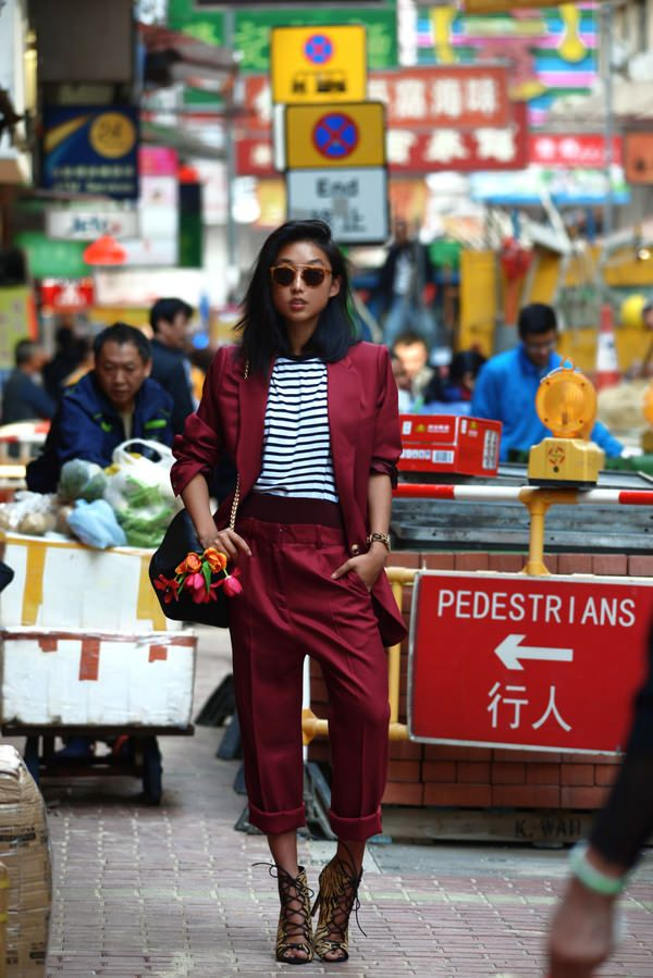 Margaret Zhang in a red Acne blazer.