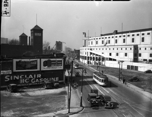 Michigan Ave., Detroit in 1937 before it was widened. A 25 yr. old Tiger Stadium (then Navin Field) sits on the right