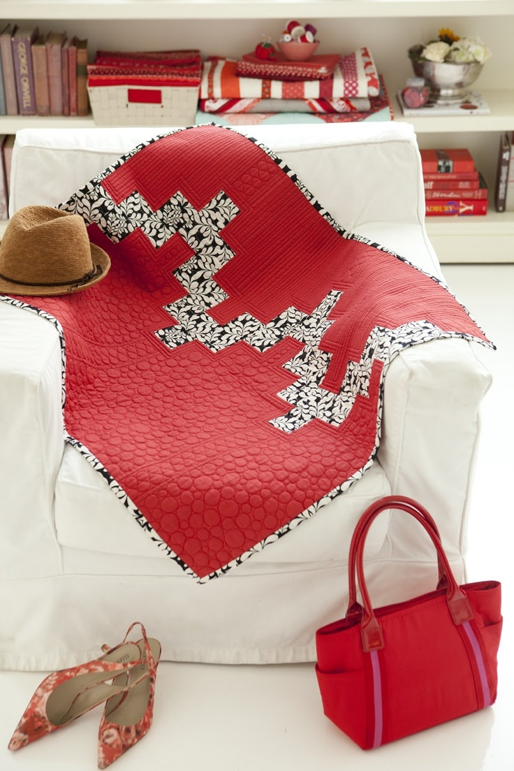 A husband/wife duo created this lap quilt in for the Sew Red Book.  Love how each half is quilted differently.